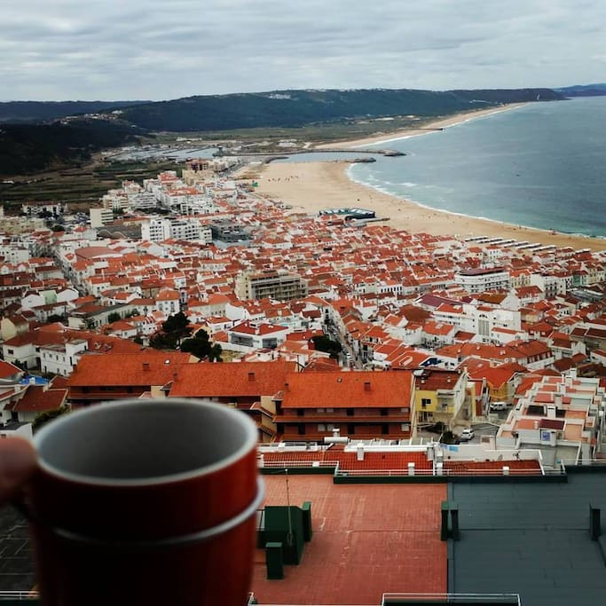 Cup of coffee with ocean view