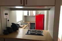 Kitchen with fridge freezer and stove