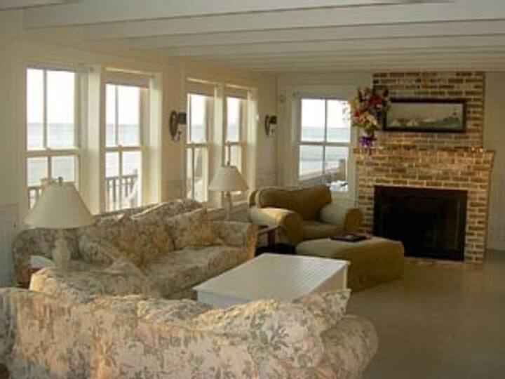 Nantucket-style oceanfront home on a sandy beach