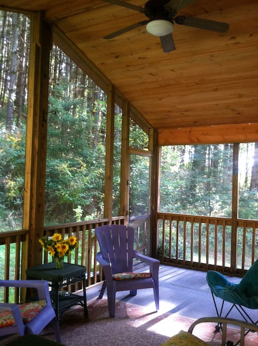 The Cedar Cabin has a lovely, private screen porch surrounded by pine forest