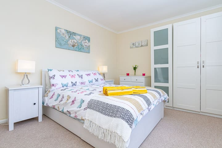 Spacious double bedroom with ample storage from under bed storage to chest of draws & wardrobe space.  Bedside cabinets & table side lamps with a street view of Cathay's.