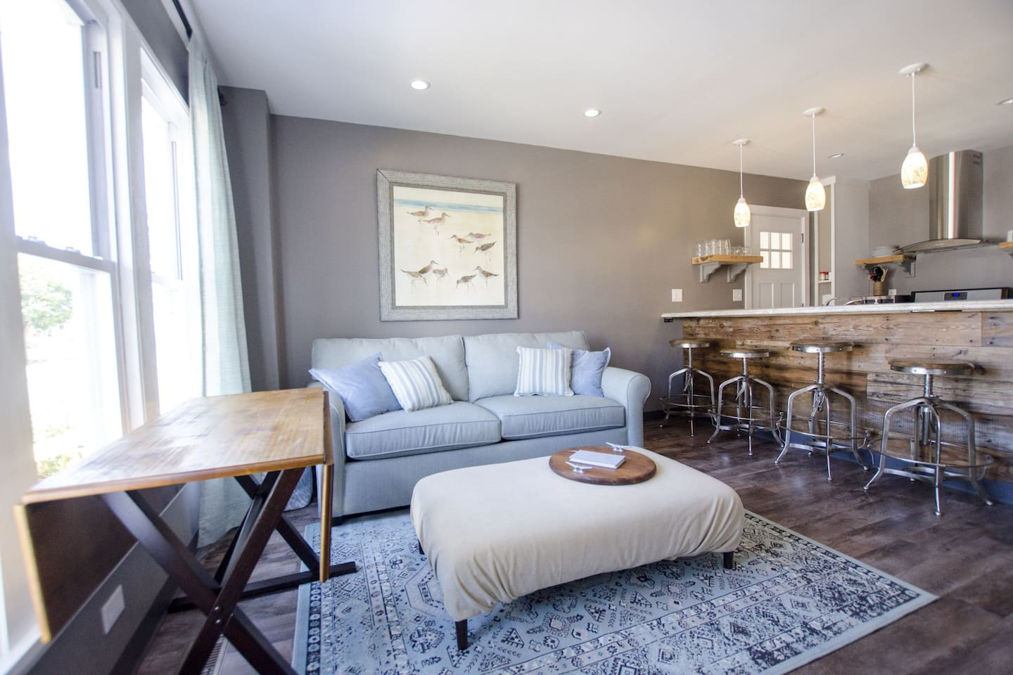 """This is the living area of unit """"A"""".  Shown is a queen size sleeper sofa and the breakfast bar.  Unit """"B"""" is built as a mirror image. It both units are desired there are common doors that can join the two units into one unit allowing for 12 family members."""
