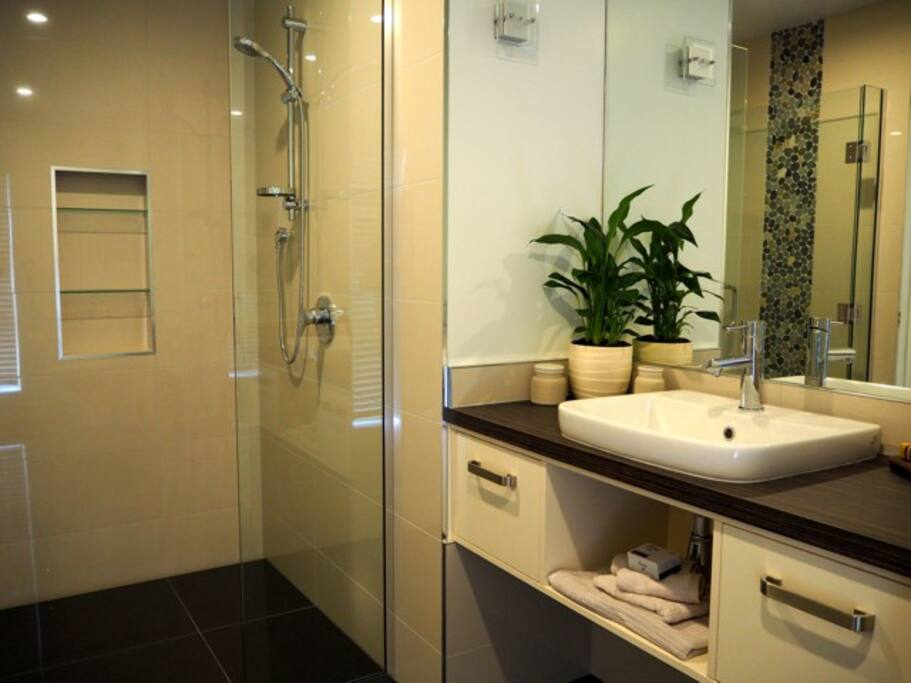 Ensuite with large level entry shower.