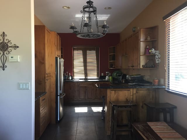 Kitchen with full amenities. Full size refrigerator and freezer, stove, oven, sink, coffee maker, blender, toaster, pots and pans.