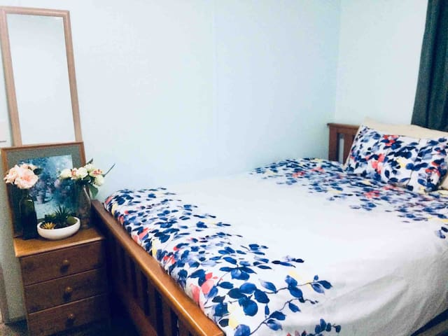Large queen Bed in bedroom with separate lock