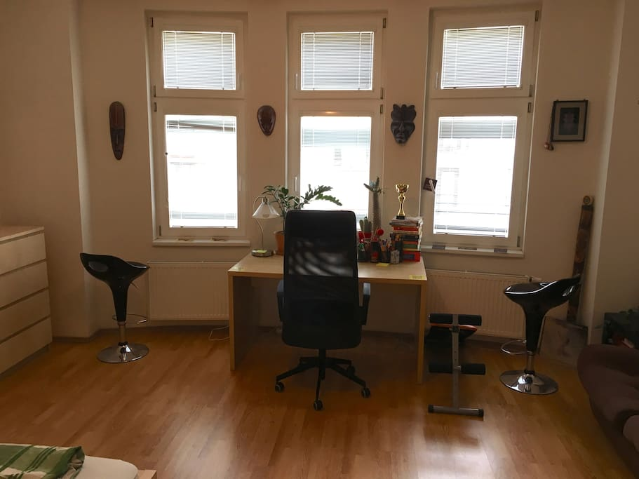 Part of the room - work desk with comfortable chair.