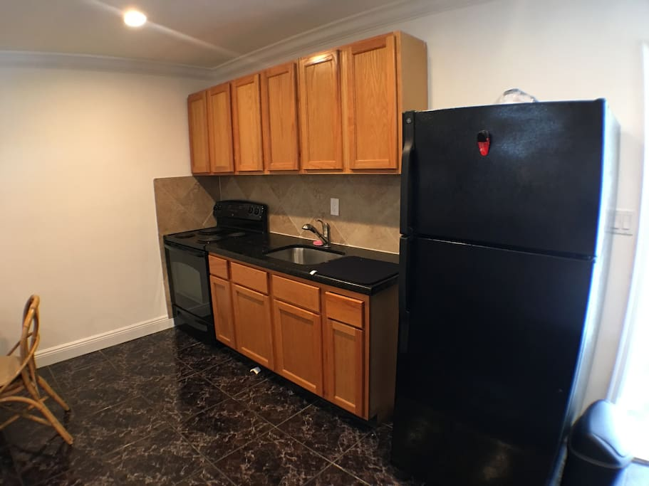 Store your goods inside these wooden-polished cabinets and spacious refrigerator. The suite also includes a top-quality coffee maker and stove.