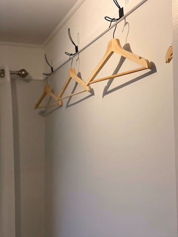 Hanging area in each room with 4 hangers