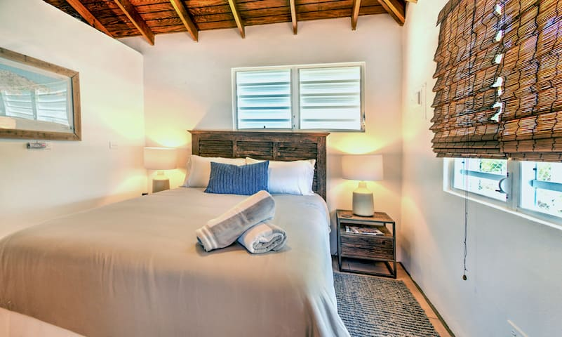 The guest bedroom includes a queen bed, with a luxurious memory foam mattress and cool cotton linens. Both bedrooms include a beach bag and beach towels.
