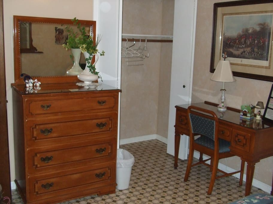 The bedroom boasts of an antique desk, a full size antique dresser and spacious closet for guests convenience.