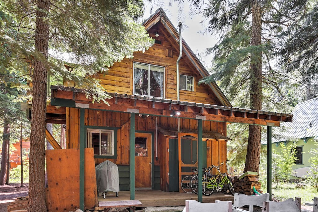 Surrounded by tall trees in a forest setting, this cabin ensures a relaxing retreat.