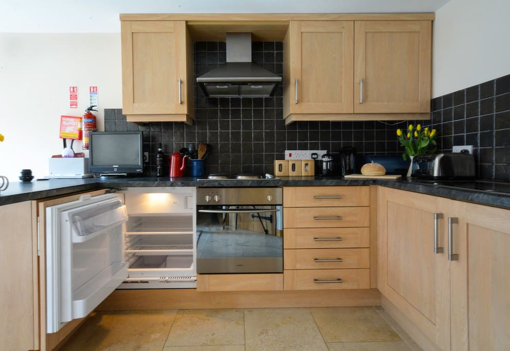 Our fully equipped kitchen has an oven and hob with a small fridge freezer.  We do also have extra freezer space in the garage should you need it.