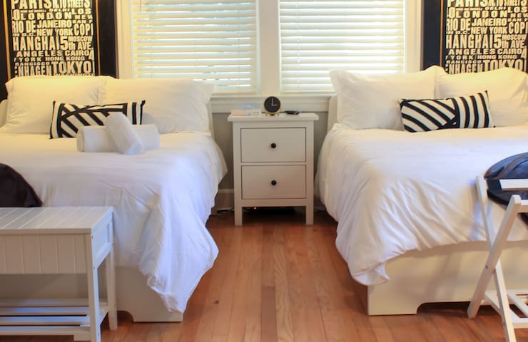 Double room with two full sized beds decorated to perfection