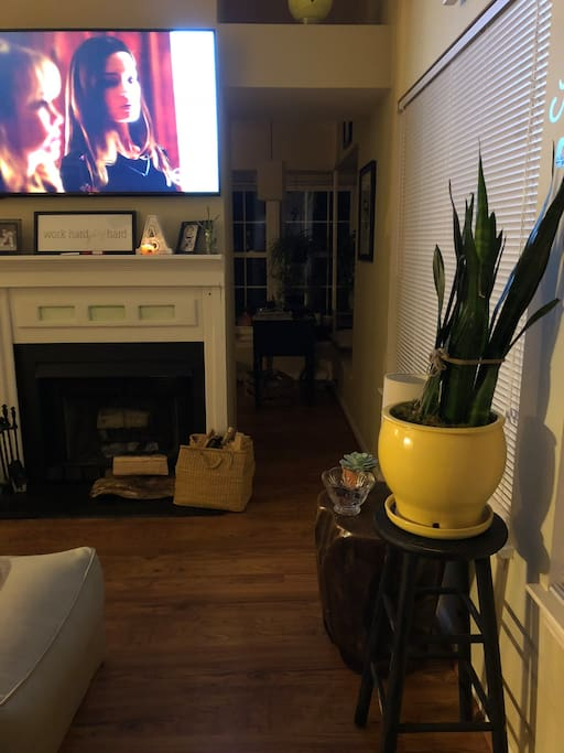 Taken at entrance. Den area and sunroom/office w TV