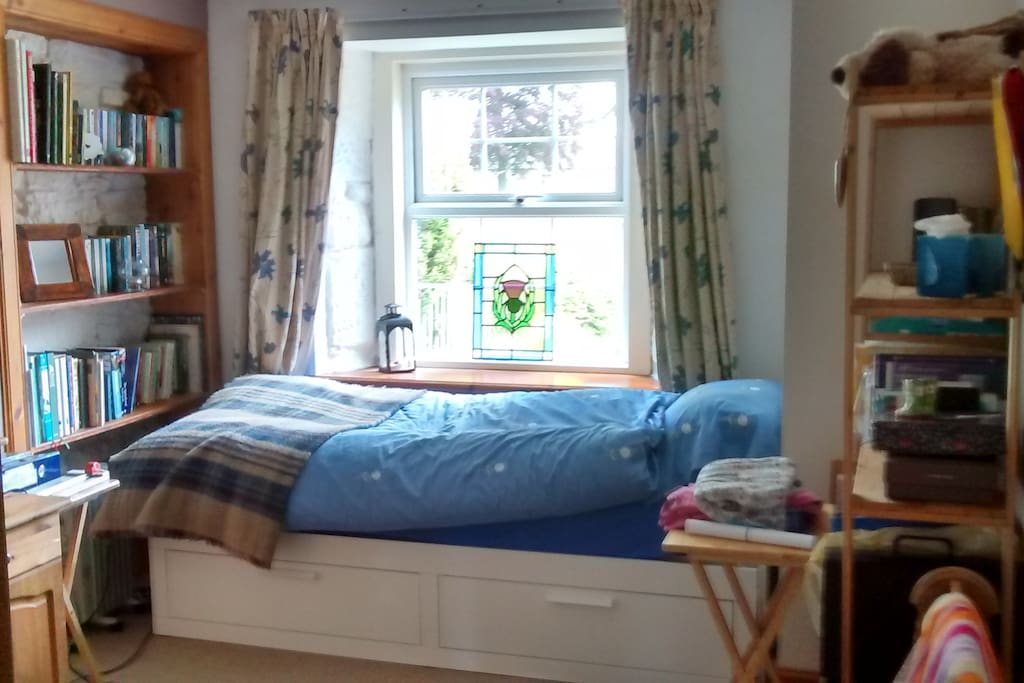 Single bed pulls out to kingsize
