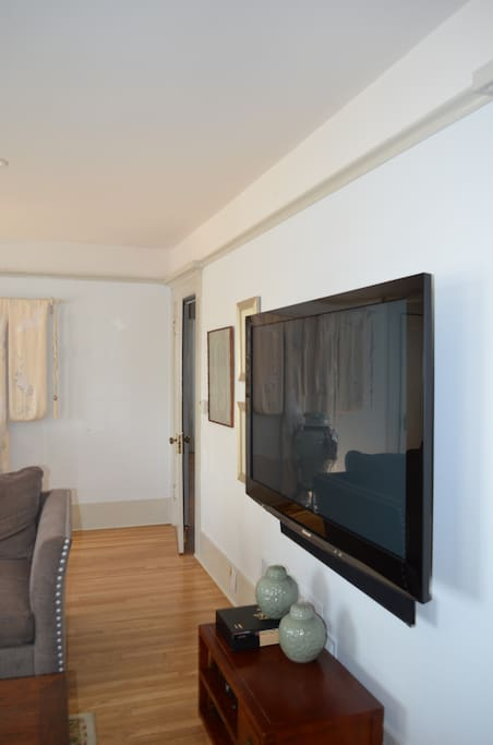 """54""""  wall mounted TV with 5.1 surround sound system"""