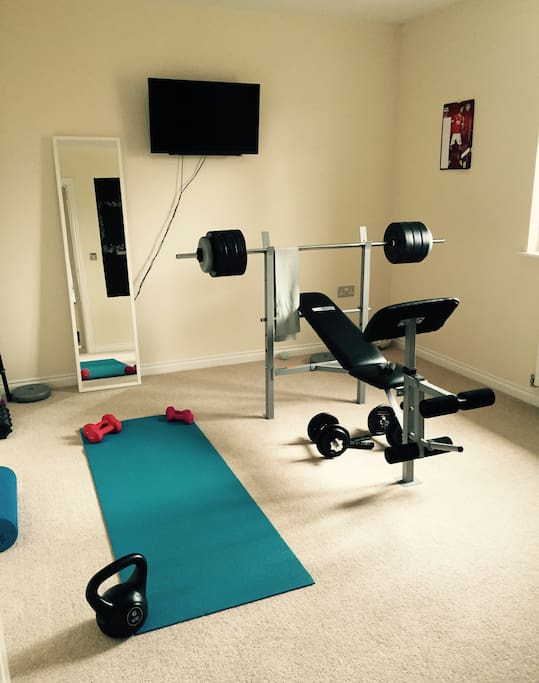 Private living area with TV and sofa, and gym equipment if required.