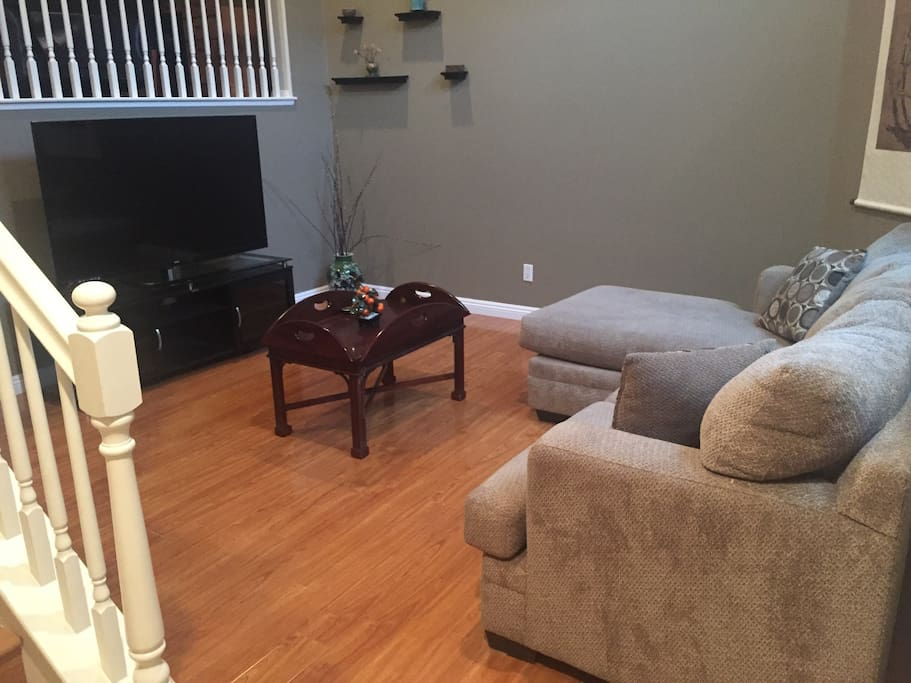 1st floor living room with TV and sofa