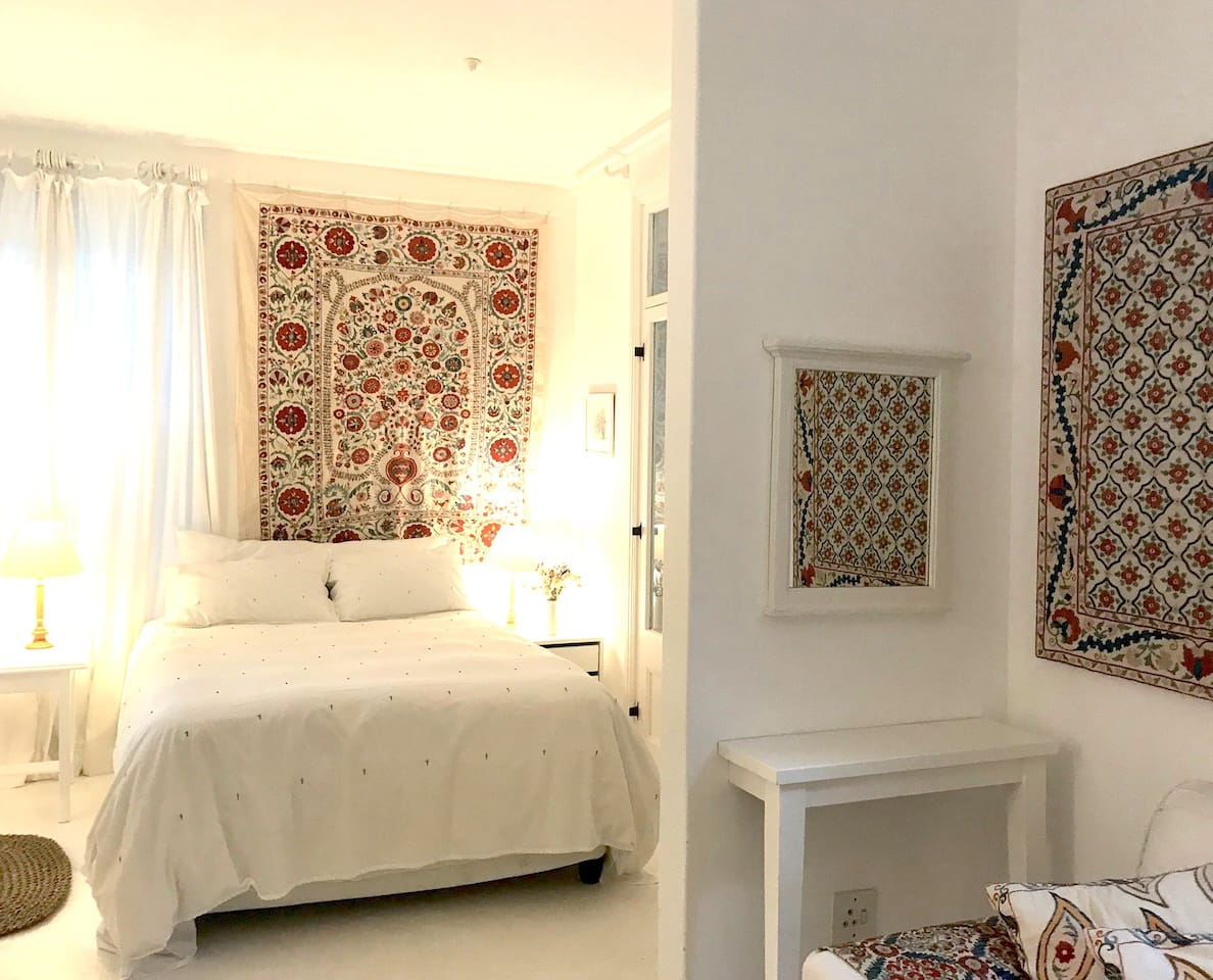 The bedroom is light and airy and very quiet, only birdsong outside. It is decorated with a few Suzanis from the Suzani Gallery at our home.