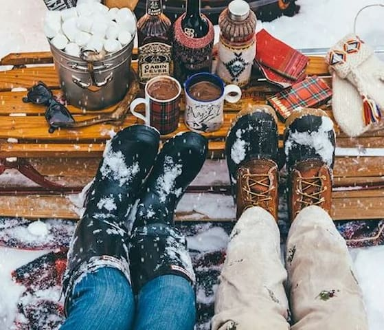 Get cozy at the backyard firepit.  Chairs and vintage sled provided!
