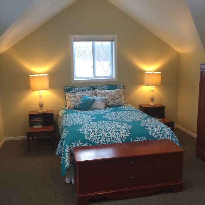 Upstairs, comfortable queen bed with space to relax.