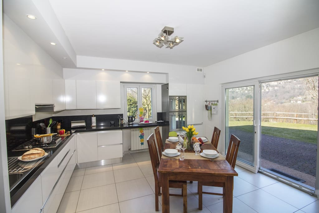 Kitchen, fully equipped with access to the private garden