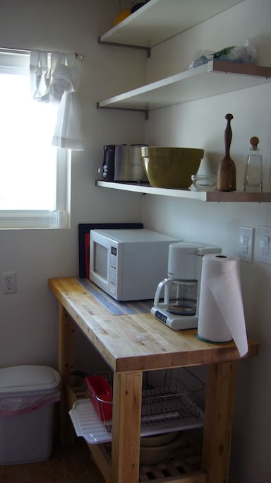 microwave, coffee maker, dishes, bowls, wineglasses, etc