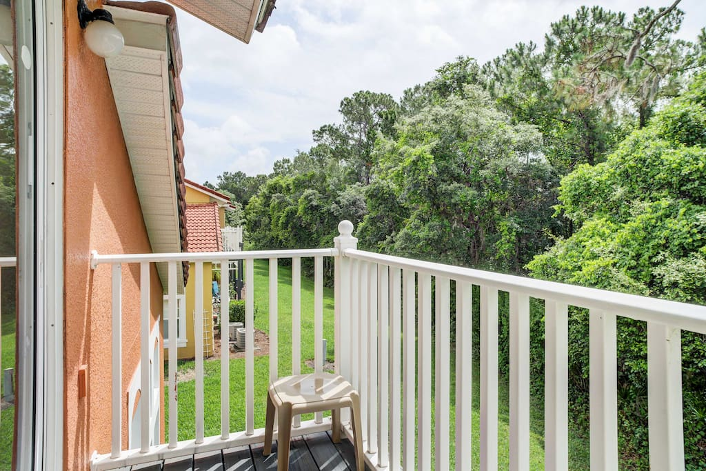 Surrounded by a conservation area, you'll enjoy verdant foliage and serene views from the top balcony.
