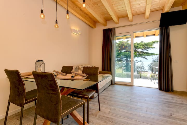 Modern Holiday Apartment with Wi-Fi, Air Conditioning, Pool, Lake View & Garden; Garage Available, Pets Allowed