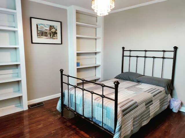 Main floor bedroom with full size bed
