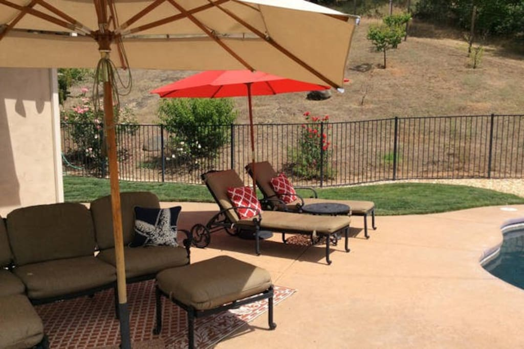 Multiple shaded seating areas around the pool