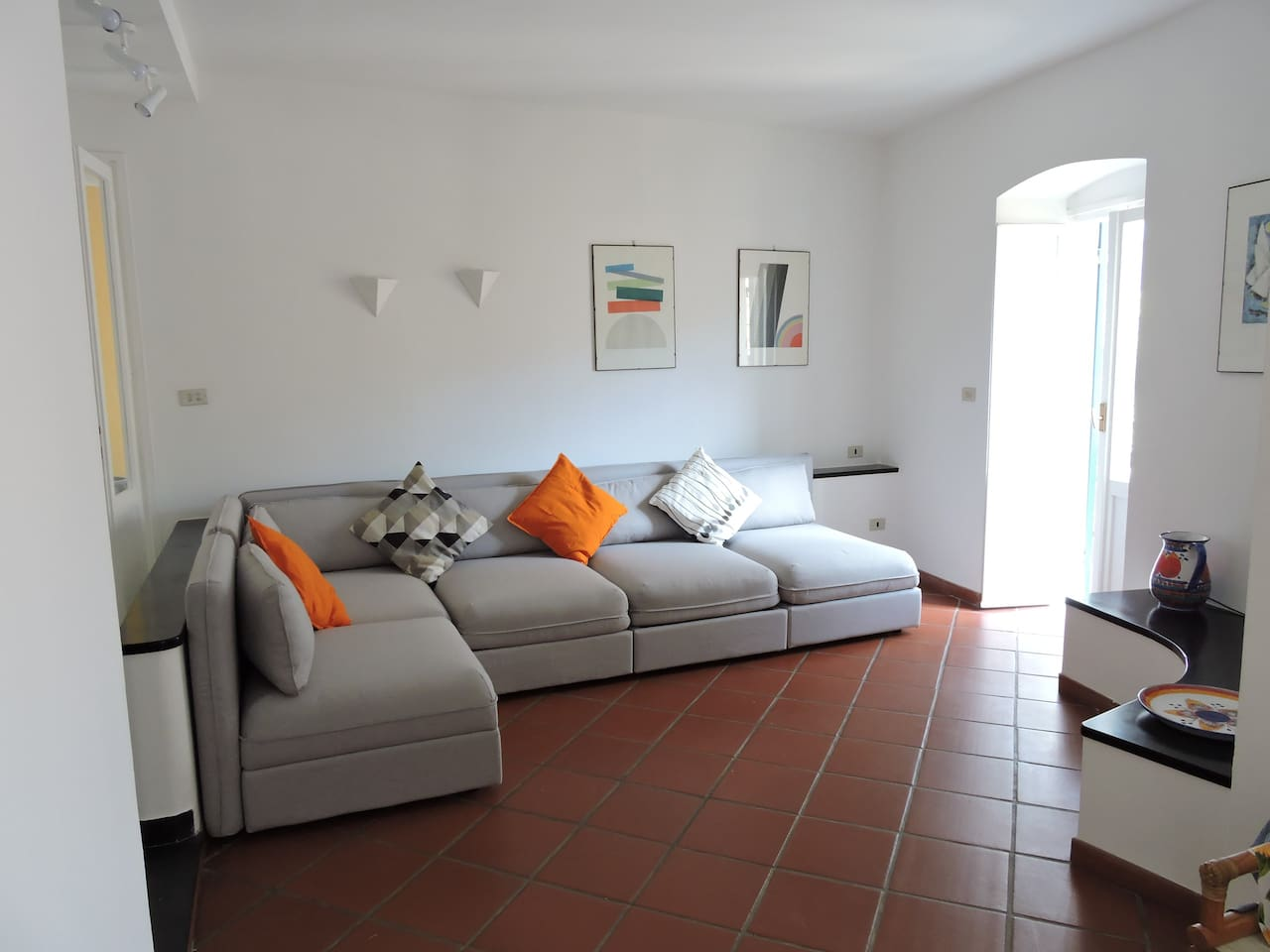 Open plan lounge and seating area with sofa bed