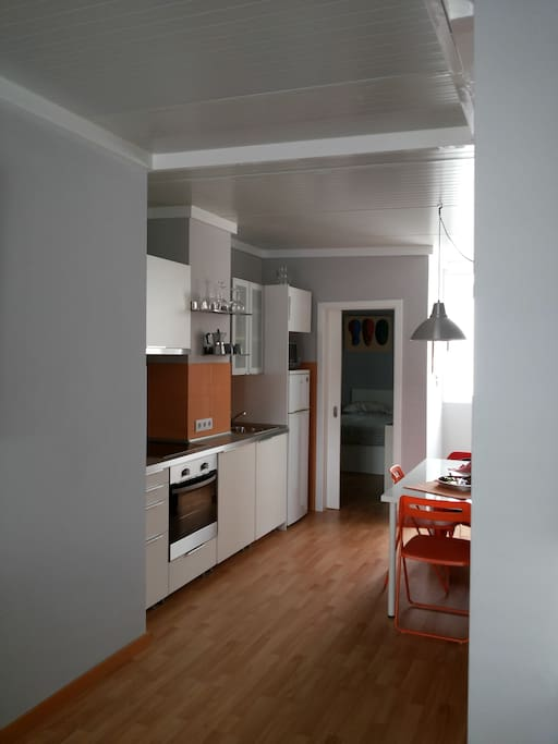 Integrated kitchen in the living-room