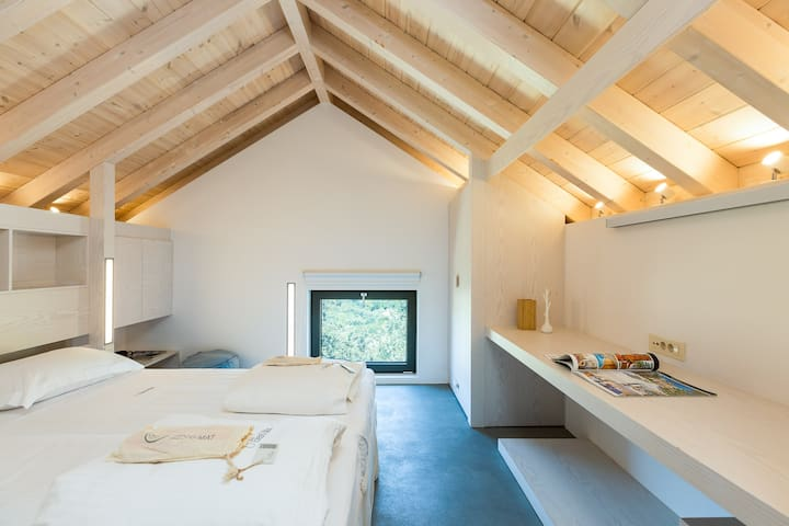 Bedroom with 2 single beds on our Loft