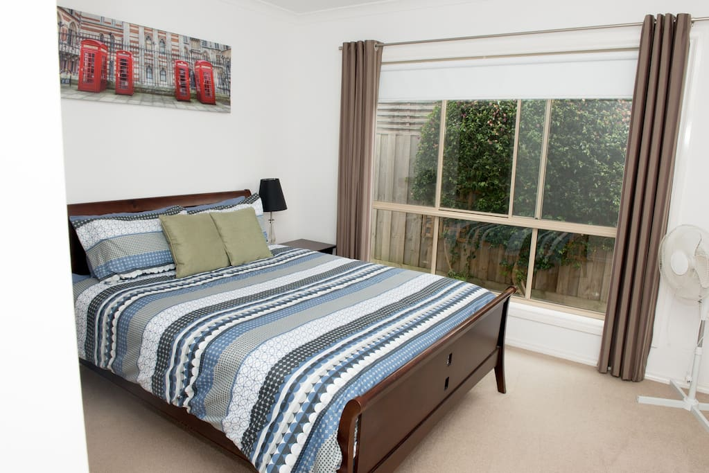 Bedroom 1 has a queen size bed - is light and modern and has a walk in Wardrobe