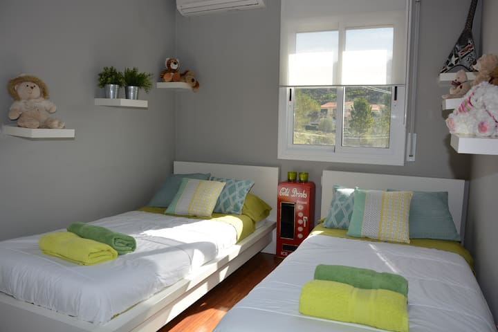 2 bedrooms with 2 single beds. Our Sitges Villas. Weekly Villas.  Floor 1