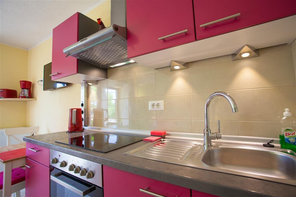 Kitchen with oven and glass ceramic cooking stove