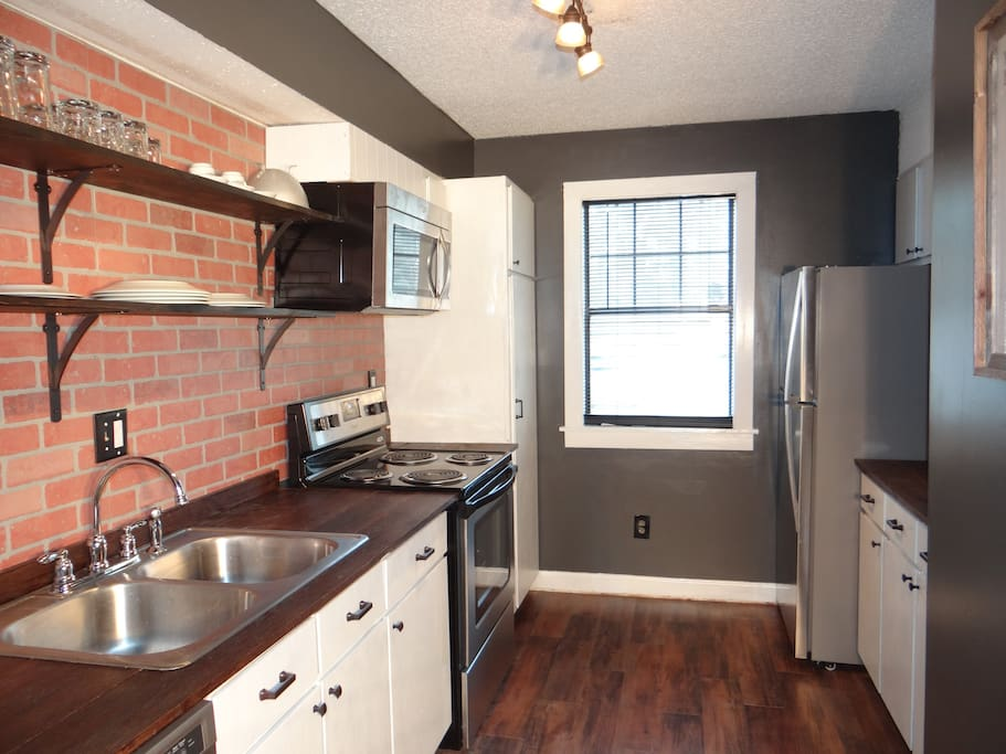 The completely renovated kitchen boasts stainless steel appliances and everything a cook would need to make a great meal.