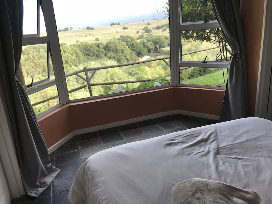 Bedroom with a view of river