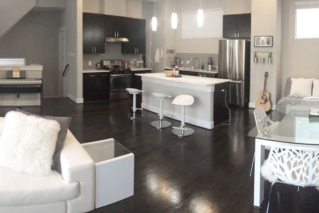 Living/dining/kitchen offers plenty of space to work and relax in. The area features 9-foot ceilings and lots of light.