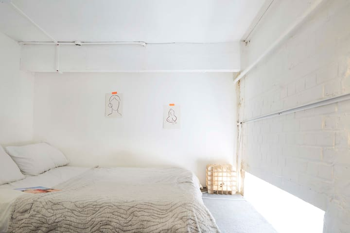 This is the bedroom which is above the personal office.  The room is short in height but perfectly cosy for sleeping & plenty of room for two people.