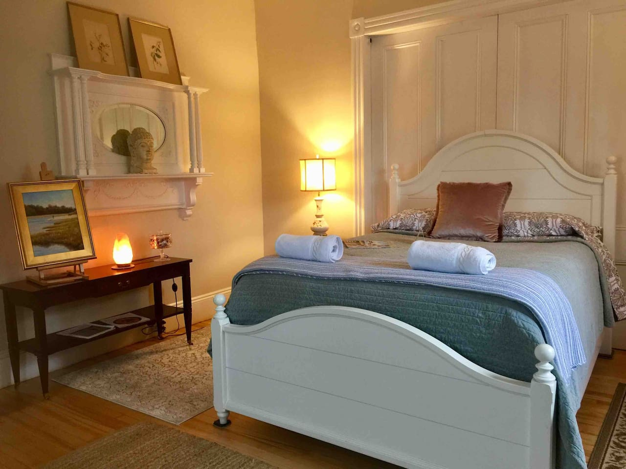 The Monet room has a queen size bed, antique furniture and original local paintings