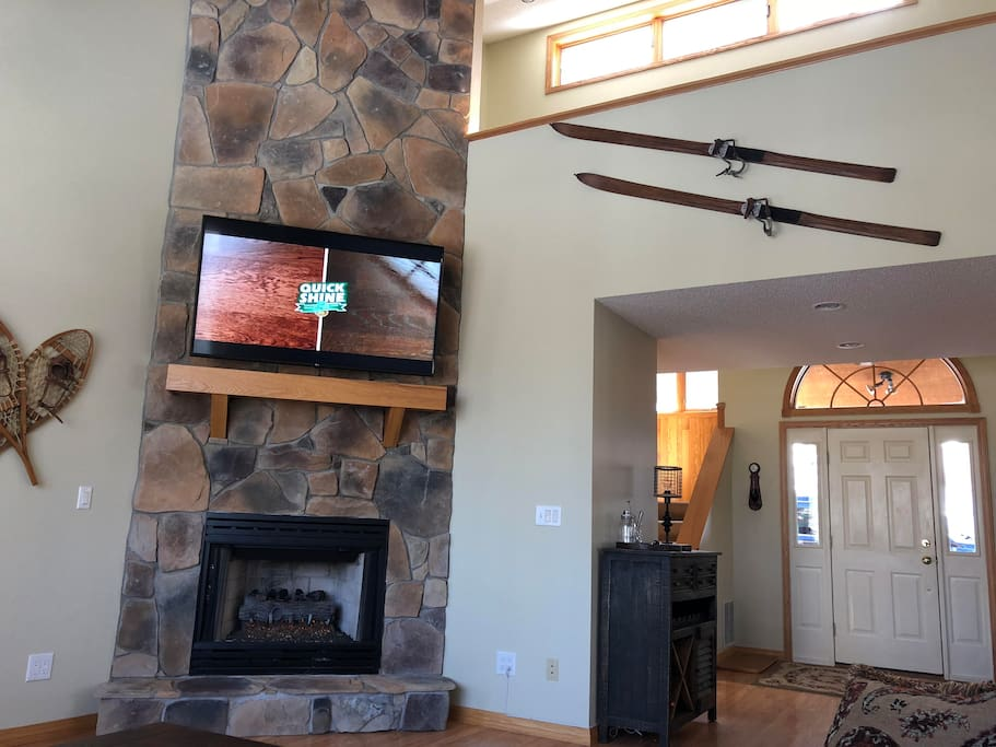 """Living room fireplace and 65"""" TV"""
