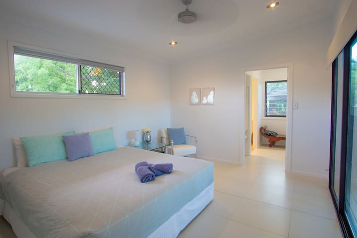 Downstairs bedroom (king bed) with ensuite, and direct access to pool deck