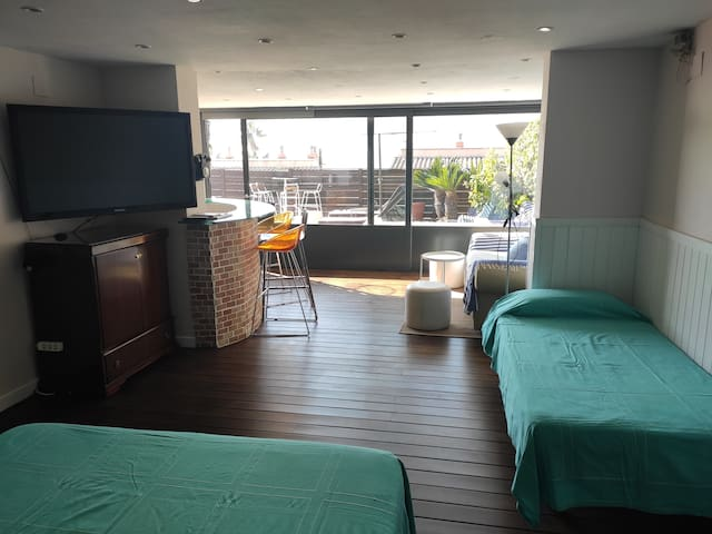 Loft space with: big bed, single bed and comfortable sofa.