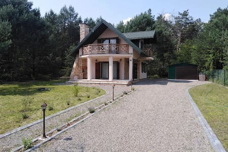 House by the lake in the forest buffer zone