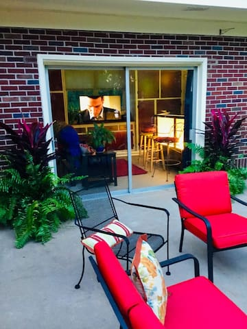 "Comfortable and private patio. View looking toward Sports Bar with 55"" HD Smart TV and a Queen Futon Sleeper"