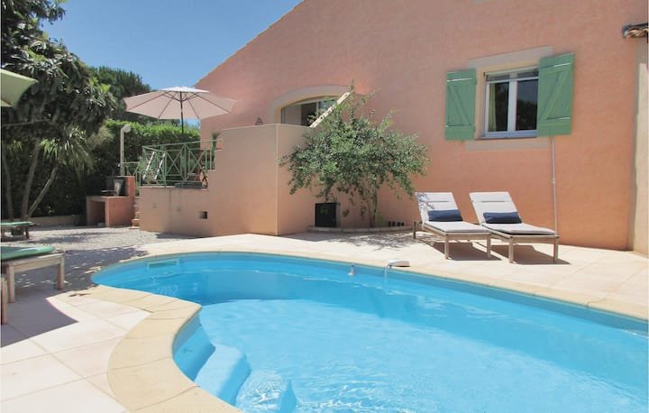 Awesome home in Creissan with Outdoor swimming pool, Heated swimming pool and 5 Bedrooms