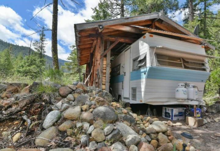 Try Tiny Living in a Cozy Creekside Vintage Camper