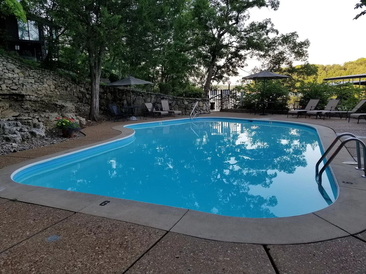 One of 3 outdoor pools in Treetop Village.  You can see this house in the background.